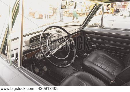 Interior Of Classic Soviet Union Vintage Car. An Interior Of The Retro Old Car. Steering Wheel Of Ol