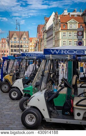 Wroclaw, Poland - August 7, 2021: A Row Of Rickshaws Waiting For The Tourist In The Old Town Square