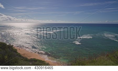 View From Above To Diamond Head Beach Park. People Swim In The Ocean. Yellow Sand On The Beach On Th
