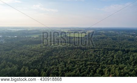 Aerial View With A Drone Of A Spring Wavy Agricultural Countryside Landscape With Plowed And Unplowe