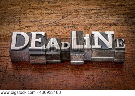 deadline word in mixed vintage metal type printing blocks over grunge wood, business and planning concept