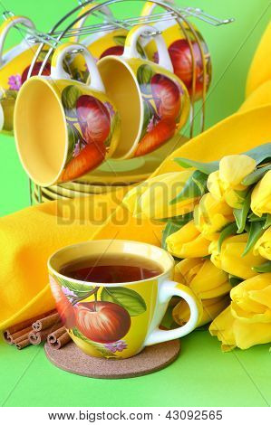 Tea Cups And Yellow Tulips