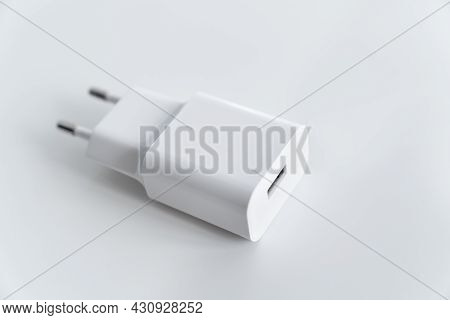 Ac Charger With Usb Connector For Smartphone Or Tablet On A White Background.