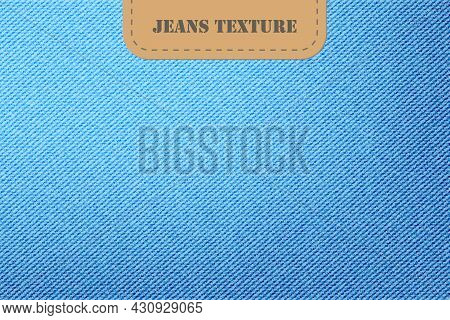 Vector Background Of Denim Blue Jeans Texture. Fashion Light Blue Canvas Material With Leather Label