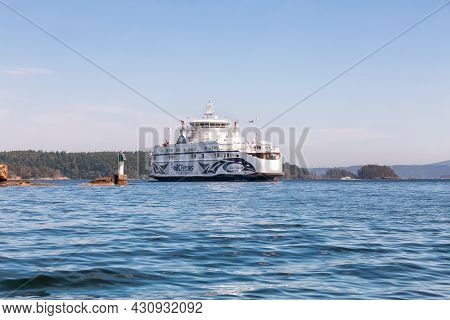 Victoria, Vancouver Island, British Columbia, Canada - August 15, 2021: Bc Ferries Boat Arriving To