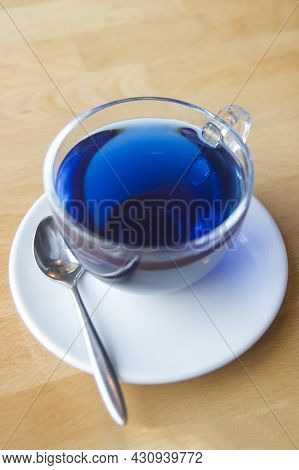 Refreshing Blue Chinese Tea In A Transparent Mug On A Wooden Table