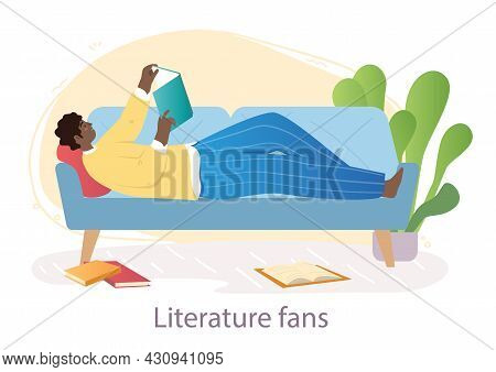 Reading Books Concept. Man Fond Of Literary Works. Character Lying On Sofa In Apartment Along With I
