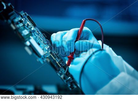The scientist works in a modern scientific laboratory for the research and development of microelectronics and processors. Microprocessor manufacturing worker uses computer technology and equipment.