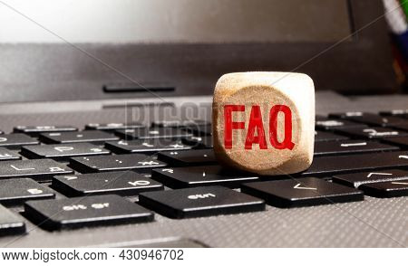 Businesswoman Hand Holding Faq Word With Wooden Cube Block. Mergers And Acquisitions, Information, C