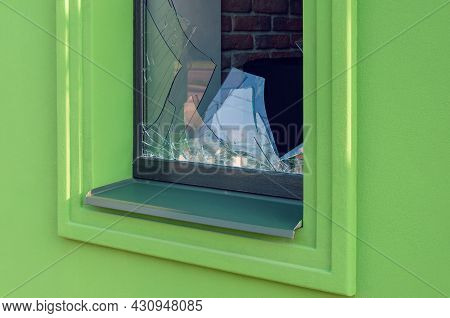 Broken Green Facade Window Glass In Close-up