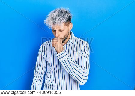 Young hispanic man with modern dyed hair wearing business striped shirt feeling unwell and coughing as symptom for cold or bronchitis. health care concept.