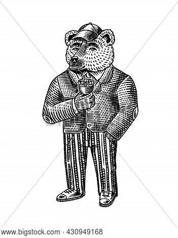 The Bear Drinks Wine Or Cocktail From A Glass With A Straw. Fashion Character In A Cap And Tweed Sui