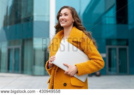 Business Woman With Laptop Dressed Yellow Coat Standing Outdoors Corporative Building Background Cau