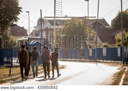 Obrenovac, Serbia - August 15, 2021: Young Afghani Refugees From Afghanistan, Men, Walking To A Bus