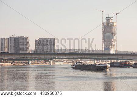 Belgrade, Serbia - March 13, 2021: Cargo Ship, A Barge, Under Stari Savski Most Bridge On Sava River