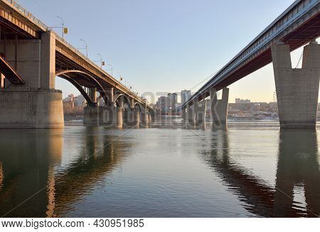 Bridges Over The Ob In Novosibirsk. The World's Largest Metro Bridge And Automobile Arched October B