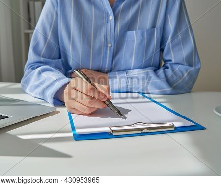 Faceless Female Person Writing On Clipboard. Concept Of Secretary Or Inspector In Formal Clothes. Si