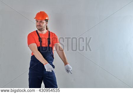 In Blue Overalls, A Smart Worker Stands