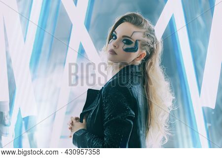 Portrait of an attractive sci-fi cyborg girl. Cyberpunk concept. Make-up and hairstyle.