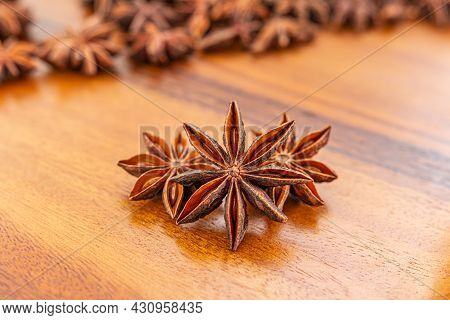 Star Anise On Wooden Background. Close-up, Selective Focus.