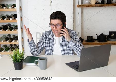 Annoyed Business Woman Arguing With Her Interlocutor On Phone.