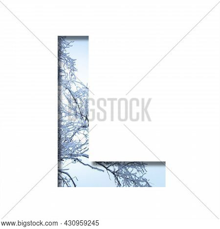 Winter Letters. The Letter L Cut Out Of Paper On The Background Of The Winter Sky And Snow-covered T