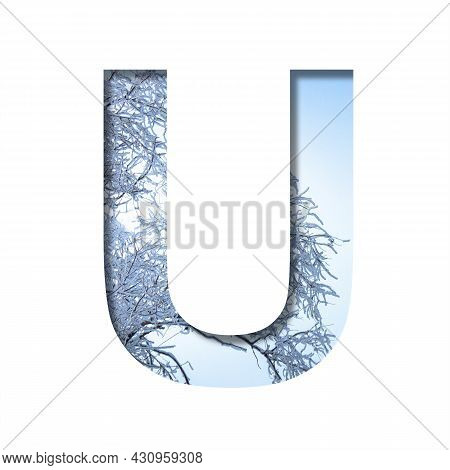 Winter Letters. The Letter U Cut Out Of Paper On The Background Of The Winter Sky And Snow-covered T