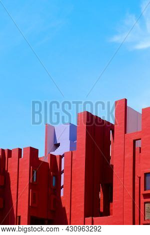 Calpe, Spain - August 2, 2021: The picturesque La Muralla Roja building, in Calpe, Spain, an apartment building designed by Ricardo Bofill and built in 1972, against the blue sky