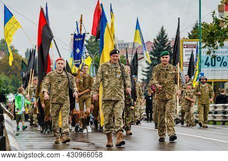 Uzhgorod, Ukraine - August 24, 2021: Soldiers And Veterans On March Of Defenders, Parade In Uzhgorod