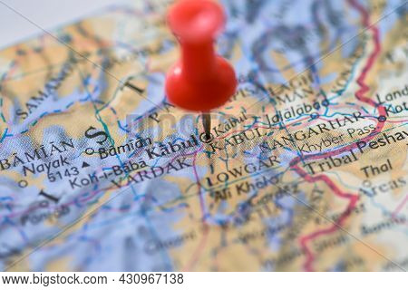 Kabul, Afghanistan On Globe Map Atlas With Red Push Pin Thumbtack Marker In Macro Closeup Of Middle