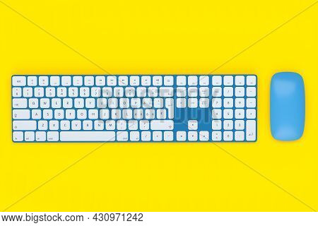 Modern Blue Aluminum Computer Keyboard And Mouse Isolated On Yellow Background.