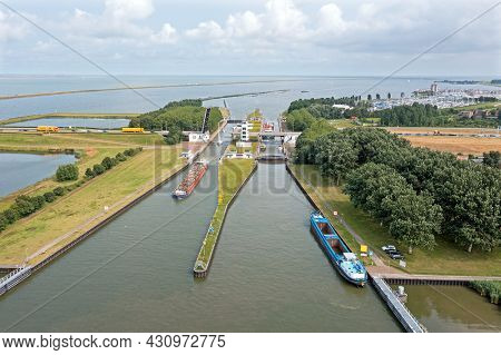 Aerial from freighters at the Houtrib sluices near Lelystand in the Netherlands