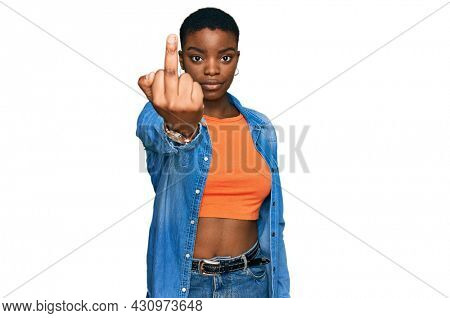 Young african american woman wearing casual clothes showing middle finger, impolite and rude fuck off expression
