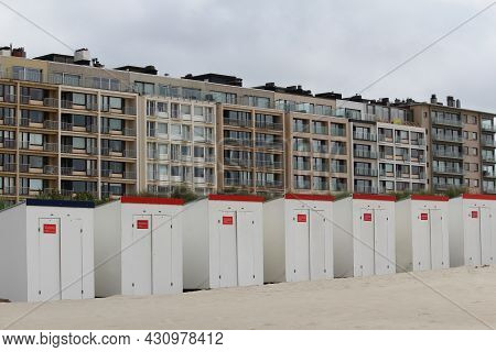 Rows Of Beach Huts And Appartment Blocks At Nieuwpoort-bad, Nieuwpoort, West Flanders On The Belgian