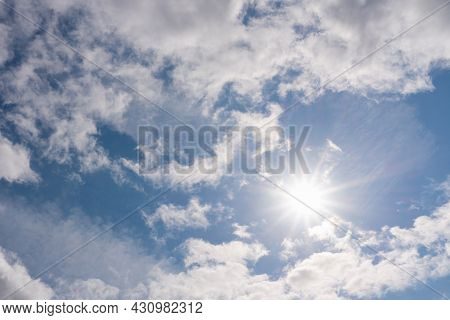 Rays Of Sunshine Breaks Through The Dark Clouds. Sun And Blue Sky With Clouds.concept Of Hope For Th