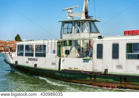 Venice, Italy - June 2, 2021: Old Ferry Boat Called Vaporetto In Motion In The Venice Lagoon To The