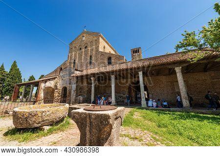 Torcello, Italy - June 2, 2021: Facade Of The Basilica And Cathedral Of Santa Maria Assunta In Venet