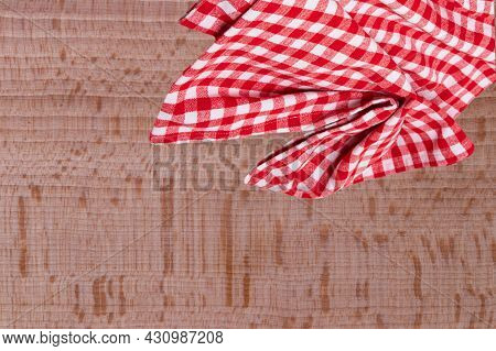 Empty Table Product. Top View Of A Wooden Table With A Red And White Checkered Tablecloth Or Napkin.