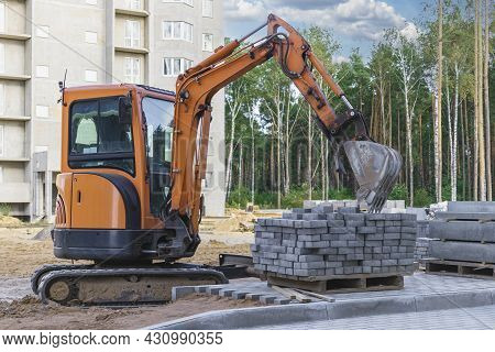 Mini Excavator At The Construction Site. Compact Construction Equipment For Earthworks