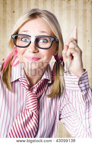 Nerd Female Salesman Pointing To Product Copyspace