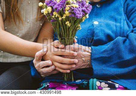 Grandparents Day, Reunited Family, Togetherness. Senior Old Grandma Hugs Granddaughter Outdoors. Gra