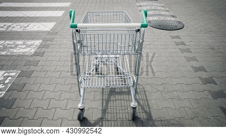 Trolley Shopping. Empty Shopping Trolley Cart At Supermarket Parking Lot. Time For Shopping Househol