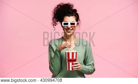 Cheerful Woman In Green Pullover And 3d Glasses Eating Popcorn Isolated On Pink