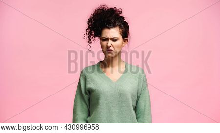 Young Woman Grimacing While Feeling Disgusted Isolated On Pink