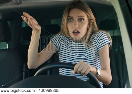 Stressed Woman In Driver's Seat Of Modern Car, View Through Windshield