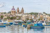 Harbor of Marsaxlokk a traditional fishing village located in the south-eastern part of Malta. poster