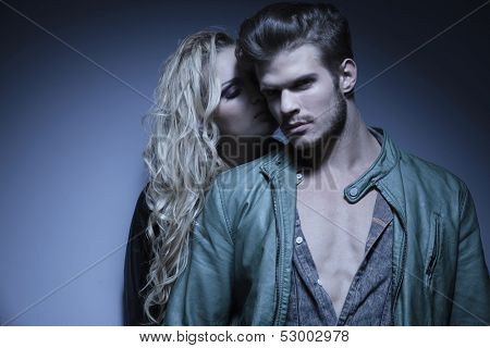 young woman standing close to her lover , fashion young couple