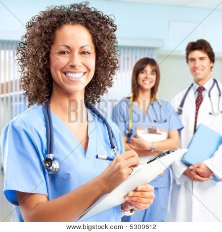 Smiling medical people with stethoscopes. Doctors and nurses poster