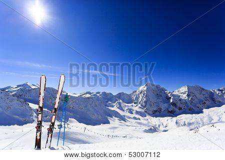Ski, winter season , mountains and ski equipments on ski run