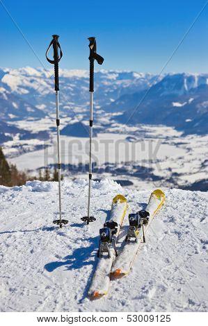 Mountains skis and ski-sticks - St. Gilgen Austria - nature and sport background poster